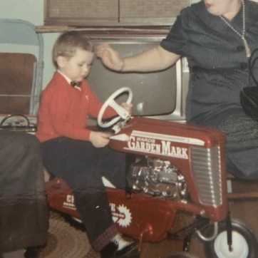 Cousin Steve on his new tractor, 1967