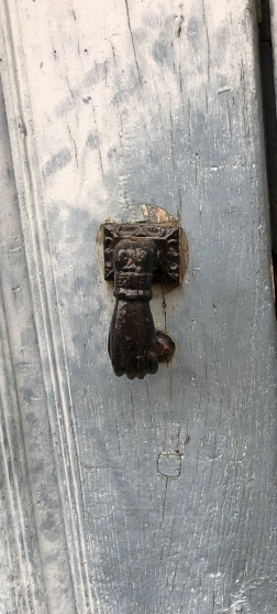 The door knockers are known as the Hand of Fátima--due to Moorish influence.